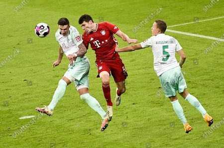 BayernMunich's Benjamin Pavard (C) in action against Bremen players Marco Friedl (L) and Ludwig Augustinsson (R) during the German Bundesliga soccer match between FC Bayern Munich and SV Werder Bremen in Munich, Germany, 21 November 2020.