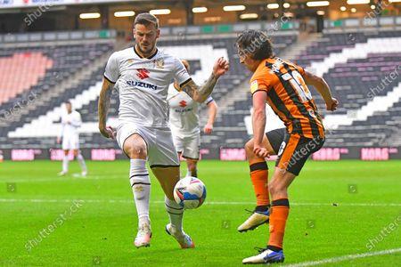 MK Dons' Midfielder Ben Gladwin (7) and Hull City midfielder George Honeyman (10) battles for possession during the EFL Sky Bet League 1 match between Milton Keynes Dons and Hull City at stadium:mk, Milton Keynes