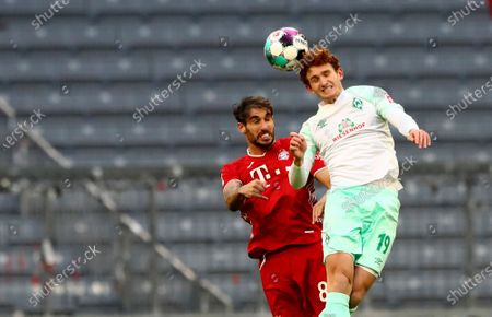 Bayern's Javi Martinez, left, jumps for the ball with Bremen's Joshua Sargent during the German Bundesliga soccer match between FC Bayern Munich and SV Werder Bremen in Munich, Germany