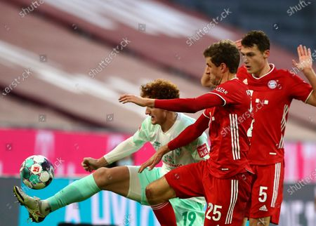 Bremen's Joshua Sargent, left, duels for the ball with Bayern's Thomas Muller, centre, and Bayern's Benjamin Pavard during the German Bundesliga soccer match between FC Bayern Munich and SV Werder Bremen in Munich, Germany