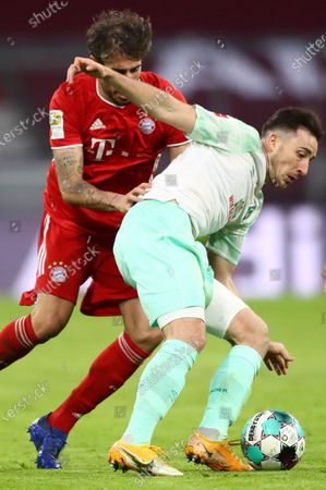 Bremen's Kevin Mohwald, right, duels for the ball with Bayern's Javi Martinez during the German Bundesliga soccer match between FC Bayern Munich and SV Werder Bremen in Munich, Germany