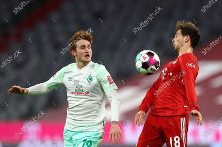 Bayern's Leon Goretzka, right, duels for the ball with Bremen's Joshua Sargent during the German Bundesliga soccer match between FC Bayern Munich and SV Werder Bremen in Munich, Germany