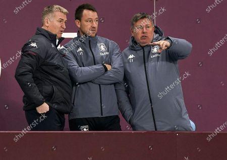 Aston Villa head coach Dean Smith (L) and assistant coach John Terry (C) react during the English Premier League soccer match between Aston Villa and Brighton Hove Albion in Birmingham, Britain, 21 November 2020.