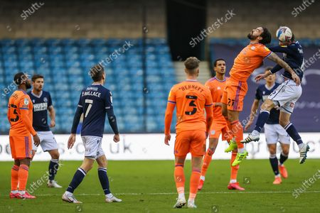Cardiff City midfielder Marlon Pack (21) and Millwall midfielder Shaun Williams (6) during the EFL Sky Bet Championship match between Millwall and Cardiff City at The Den, London