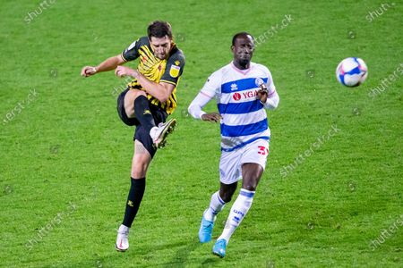 Watford defender Craig Cathcart (15) clears the ball, Queens Park Rangers midfielder Albert Adomah (37) attacking during the EFL Sky Bet Championship match between Queens Park Rangers and Watford at the Kiyan Prince Foundation Stadium, London