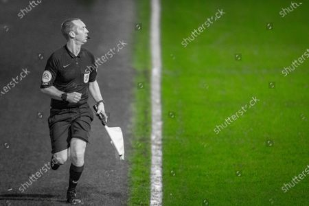 Assistant referee Carl Fitch-Jackson during the EFL Sky Bet Championship match between Queens Park Rangers and Watford at the Kiyan Prince Foundation Stadium, London