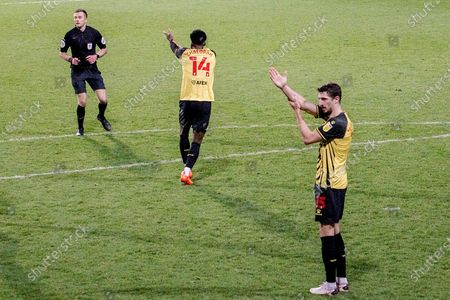 GOAL DISALLOWED Watford defender Craig Cathcart (15) and Watford midfielder Nathaniel Chalobah (14) signal towards the match officials after a goal by Queens Park Rangers forward Lyndon Dykes (9) (not in picture) during the EFL Sky Bet Championship match between Queens Park Rangers and Watford at the Kiyan Prince Foundation Stadium, London