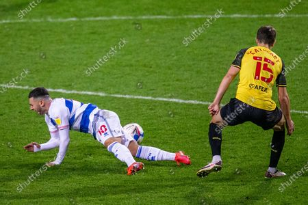 Watford defender Craig Cathcart (15) fouls Queens Park Rangers midfielder Ilias Chair (10) during the EFL Sky Bet Championship match between Queens Park Rangers and Watford at the Kiyan Prince Foundation Stadium, London