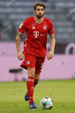 Javier Martinez of Bayern Munich runs with the ball during the German Bundesliga soccer match between FC Bayern Munich and SV Werder Bremen at Allianz Arena in Munich, Germany, 21 November 2020.