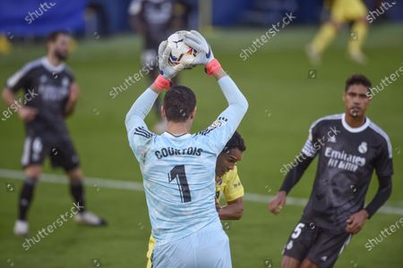 Thibaut Courtois of Real Madrid and Carlos Bacca of Villarreal CF