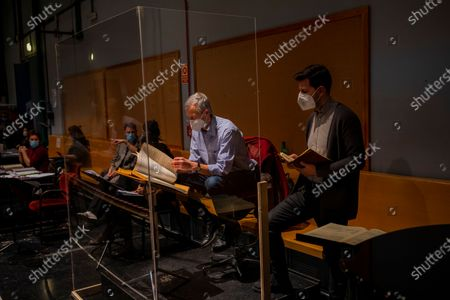 """Assistant musical director Roderick Shaw, center, conducts a rehearsal of """"Don Giovanni"""" opera at the Teatro Real, Madrid, Spain, . The theater is one of the few major opera houses that have reopened during the pandemic, although to smaller audiences"""
