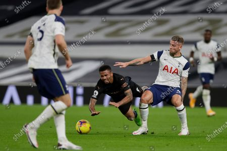 Manchester City's Gabriel Jesus, center, is tackled byTottenham's Toby Alderweireld during the English Premier League soccer match between Tottenham Hotspur and Manchester City at Tottenham Hotspur Stadium in London, England