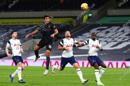 Manchester City's Rodrigo, top, heads the ball past Tottenham's Toby Alderweireld during the English Premier League soccer match between Tottenham Hotspur and Manchester City at Tottenham Hotspur Stadium in London, England