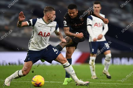 Manchester City's Gabriel Jesus, right, attempts a shot at goal in front of Tottenham's Toby Alderweireld during the English Premier League soccer match between Tottenham Hotspur and Manchester City at Tottenham Hotspur Stadium in London, England
