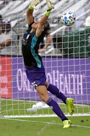 Orlando City defender Rodrigo Schlegel blocks the final New York City FC penalty kick during overtime of an MLS soccer playoff match, in Orlando, Fla. Schlegel was sent in to substitute for goalkeeper Pedro Gallese who was ejected after getting his second yellow card