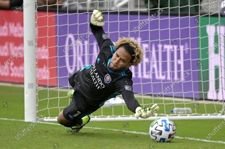 Orlando City goalkeeper Pedro Gallese is unable to make a save on penalty kick New York City FC midfielder Tony Rocha during a shootout in an MLS soccer playoff match, in Orlando, Fla