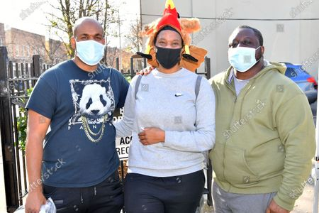 Stock Photo of Paul Dawkins, Kimberly Kinnard and Abdul Koroma of the New York State of Mind (NYSoM) non-profit hand out turkeys and apple pie for ThanksgivingPalooza 2020. https://www.nysomgroup.org/