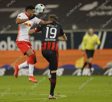 Leipzig's Christopher Nkunku (L) in action against Frankfurt's David Abraham (R) during the German Bundesliga soccer match between SG Eintracht Frankfurt and RB Leipzig in Frankfurt, Germany, 21 November 2020.