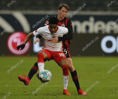 Leipzig's Christopher Nkunku (front) in action against Frankfurt's Erik Durm (back) during the German Bundesliga soccer match between SG Eintracht Frankfurt and RB Leipzig in Frankfurt, Germany, 21 November 2020.