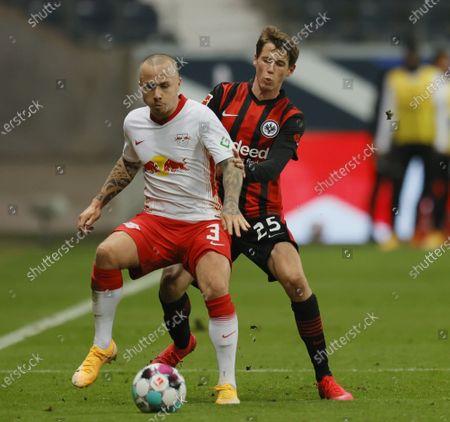 Leipzig's Jose Angelino (L) in action against Frankfurt's Erik Durm (R) during the German Bundesliga soccer match between SG Eintracht Frankfurt and RB Leipzig in Frankfurt, Germany, 21 November 2020.