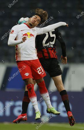 Leipzig's Justin Kluivert (L) in action against Frankfurt's Erik Durm (R) during the German Bundesliga soccer match between SG Eintracht Frankfurt and RB Leipzig in Frankfurt, Germany, 21 November 2020.