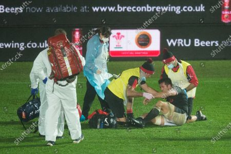 Justin Tipuric of Wales is treated by medical staff
