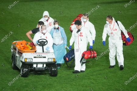 Justin Tipuric of Wales leaves the pitch with the medical staff