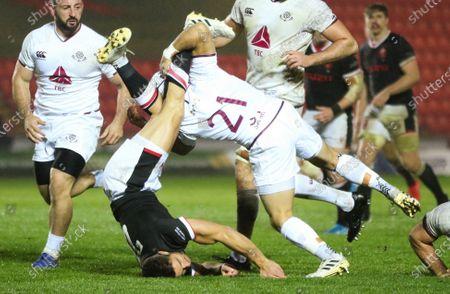 Rhys Webb of Wales off loads as he is tackled by Gela Aprasidze of Georgia