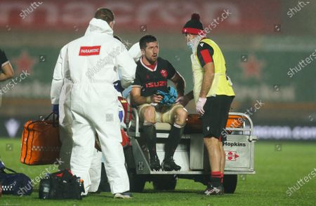 Justin Tipuric of Wales leaves the pitch after being injured