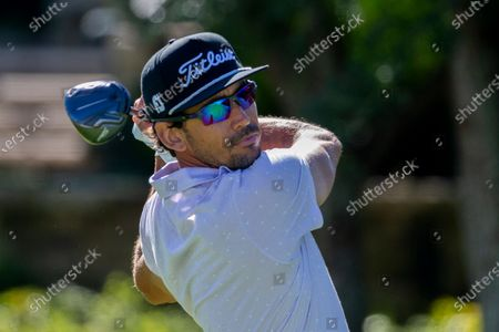 Rafa Cabrera Bello, of Spain, watches his drive down the 10th fairway during third round of the RSM Classic golf tournament, in St. Simons Island, Ga