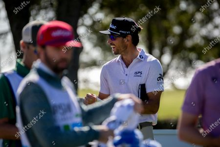 Rafa Cabrera Bello, of Spain, talks with his caddie before teeing off on the 10th fairway during third round of the RSM Classic golf tournament, in St. Simons Island, Ga