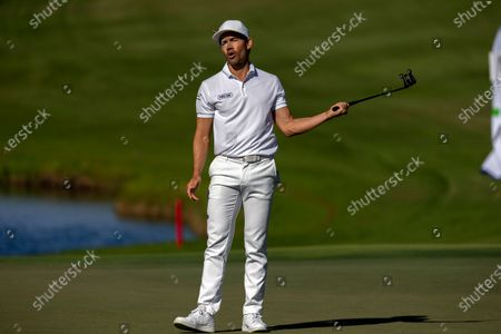 Camilo Villegas, of Columbia, reacts after missing a birdie putt on the ninth green during third round of the RSM Classic golf tournament, in St. Simons Island, Ga