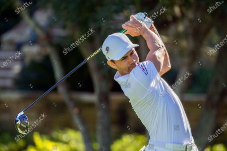 Camilo Villegas, of Columbia, watches his drive down the 10th fairway during third round of the RSM Classic golf tournament, in St. Simons Island, Ga