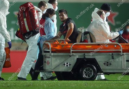 Justin Tipuric of Wales is taken off the field injured.