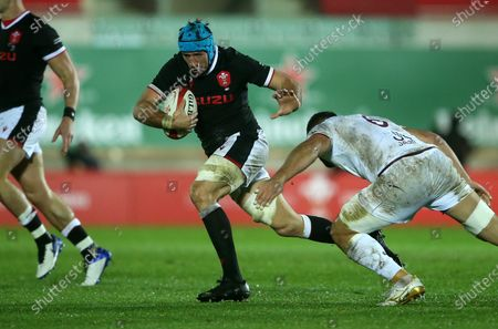 Justin Tipuric of Wales is tackled by Otar Giorgadze of Georgia.