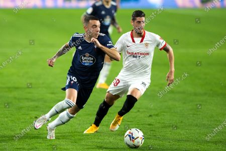 Stock Picture of Iago Aspas of Celta and Sergio Escudero of Sevilla during LaLiga, football match played between Sevilla Futbol Club and Real Club Celta de Vigo at Ramon Sanchez Pizjuan Stadium on November 21, 2020 in Sevilla, Spain.