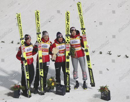 Austria's Michael Hayboeck, Philipp Aschenwald, Daniel Huber and Stefan Kraft celebrate winning the Men's Team in Wisla, Poland
