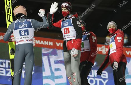 Austria's Stefan Kraft,left, and Michael Hayboeck, Philipp Aschenwald, Daniel Huber celebrate winning the Men's Team in Wisla, Poland