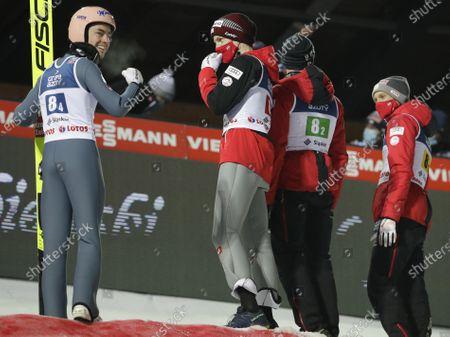 Stock Picture of Austria's Stefan Kraft,left, and Michael Hayboeck, Philipp Aschenwald, Daniel Huber celebrate winning the Men's Team in Wisla, Poland