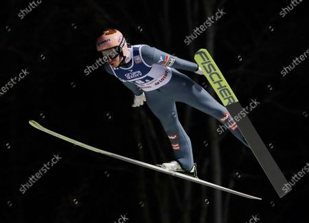 Stock Photo of Austria's Stefan Kraft soars through the air during the World Cup Ski Jumping team competition, in Wisla, Poland