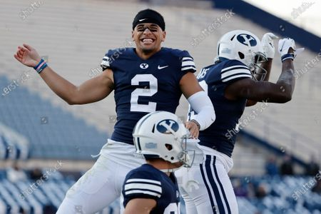 Stock Image of Wide receiver Neil Pau'u (2) congratulates running back Miles Davis, right, after his fourth quarter touchdown against North Alabama during an NCAA college football game, in Provo, Utah