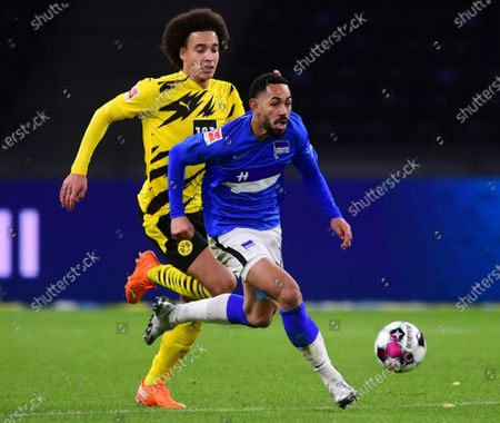Dortmund's Axel Witsel (L) in action against Hertha's Matheus Cunha (R) during the German Bundesliga soccer match between Hertha BSC Berlin and Borussia Dortmund in Berlin, Germany, 21 November 2020.
