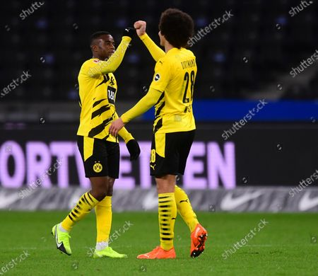 Dortmund's Youssoufa Moukoko (L) and Dortmund's Axel Witsel (R) celebrate after the German Bundesliga soccer match between Hertha BSC Berlin and Borussia Dortmund in Berlin, Germany, 21 November 2020.