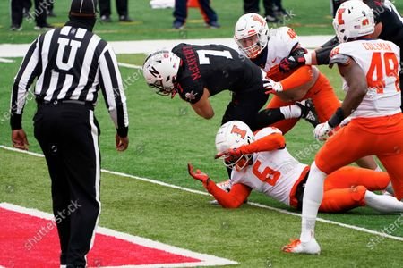 Nebraska quarterback Luke McCaffrey (7) scores a touchdown past Illinois defensive back Tony Adams (6) and defensive lineman Bryce Barnes (48), during the first half of an NCAA college football game in Lincoln, Neb