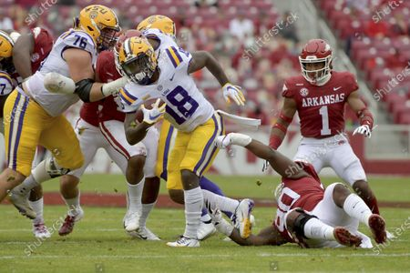 Stock Photo of Running back Chris Curry (18) spins away from Arkansas defender Marcus Miller (90) during the first half of an NCAA college football game, in Fayetteville, Ark