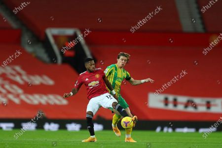 Manchester United's Fred and West Bromwich Albion's Conor Gallagher fight for the ball during the English Premier League soccer match between Manchester United and West Bromwich Albion at the Old Trafford stadium in Manchester, England
