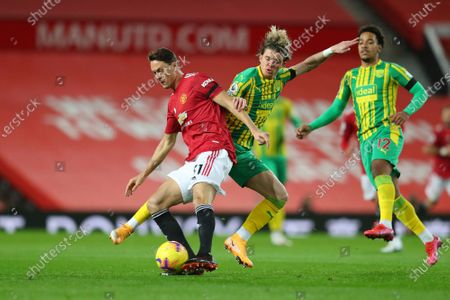 Manchester United's Nemanja Matic, left, and West Bromwich Albion's Conor Gallagher fight for the ball during the English Premier League soccer match between Manchester United and West Bromwich Albion at the Old Trafford stadium in Manchester, England