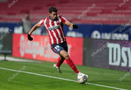 Atletico Madrid's Diego Costa runs with the ball during the Spanish La Liga soccer match between Atletico Madrid and FC Barcelona at the Wanda Metropolitano stadium in Madrid, Spain