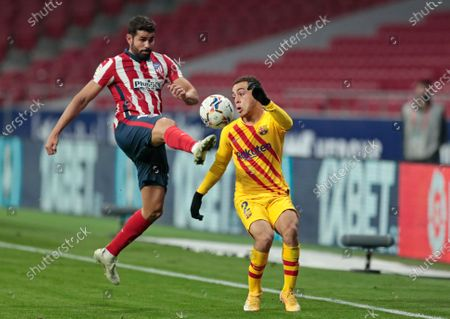 Atletico Madrid's Diego Costa, left, and Barcelona's Sergino Dest battle for the all during the Spanish La Liga soccer match between Atletico Madrid and FC Barcelona at the Wanda Metropolitano stadium in Madrid, Spain