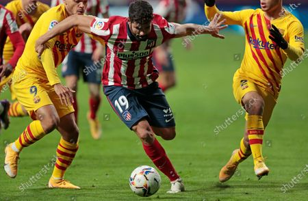 Atletico Madrid's Diego Costa in action during the Spanish La Liga soccer match between Atletico Madrid and FC Barcelona at the Wanda Metropolitano stadium in Madrid, Spain